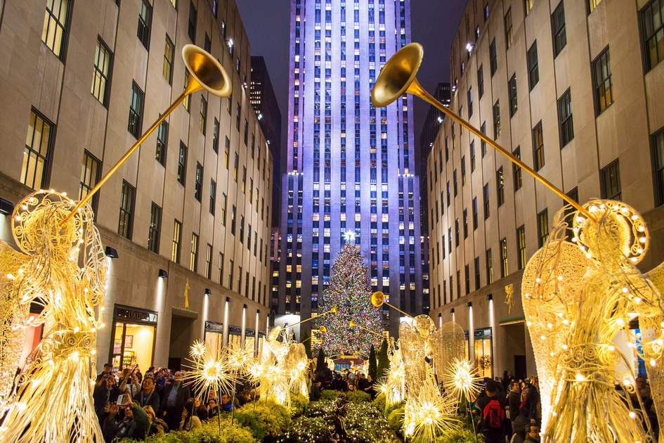 New York's Rockefeller Center, all decorated surrounding the newly lit Christmas tree