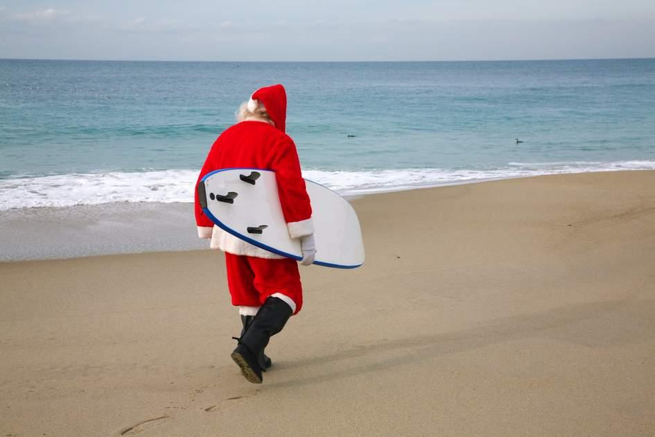 Surfing Santa in Noosa Heads, Australia