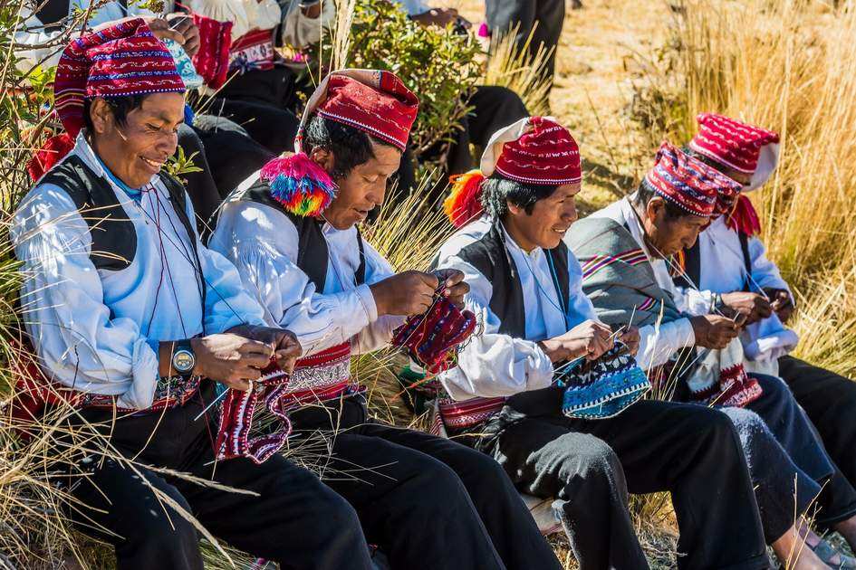 Men knitting on Taquile Island, Peru