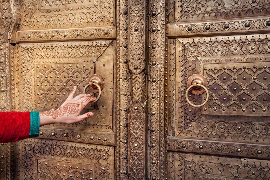 Opening a golden door in Jaipur's City Palace.