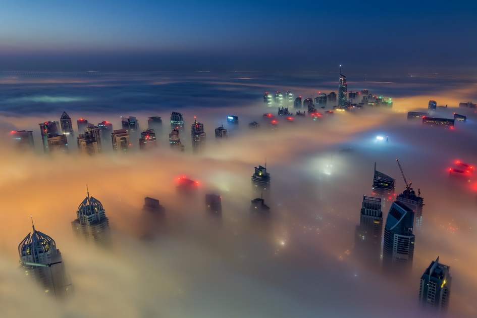 Dubai Marina's skyline under fog