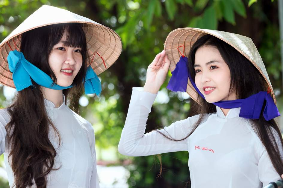Tips for visiting Vietnam: Do as the locals do and wear a hat to shelter from the sun