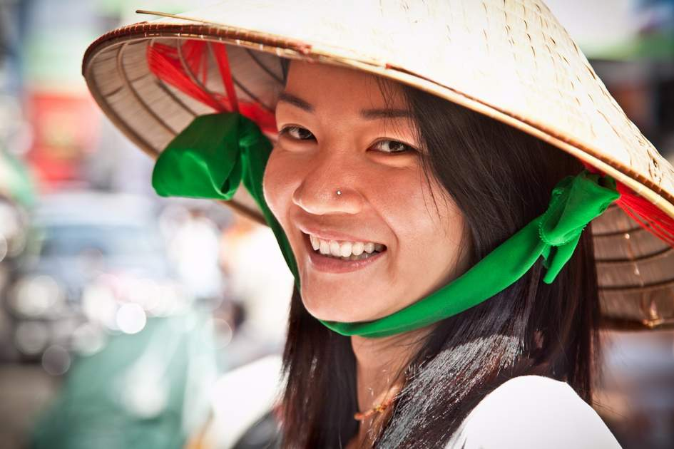 People of Vietnam: Smiling street vendor in Ho Chi Minh