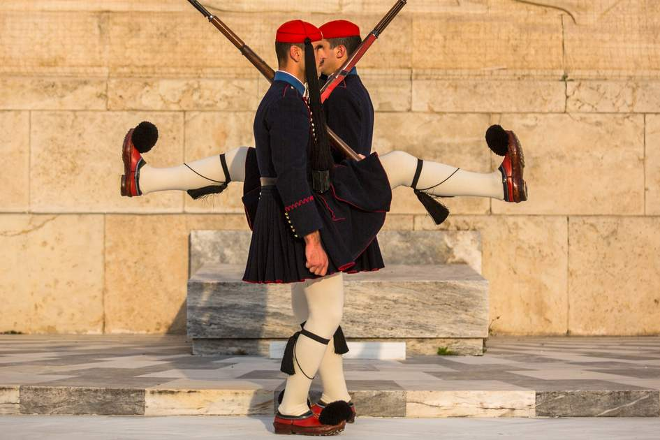 Evzone guarding the Tomb of the Unknown Soldier in Athens dressed in service uniform, refers to the members of the Presidential Guard, an elite ceremonial unit.