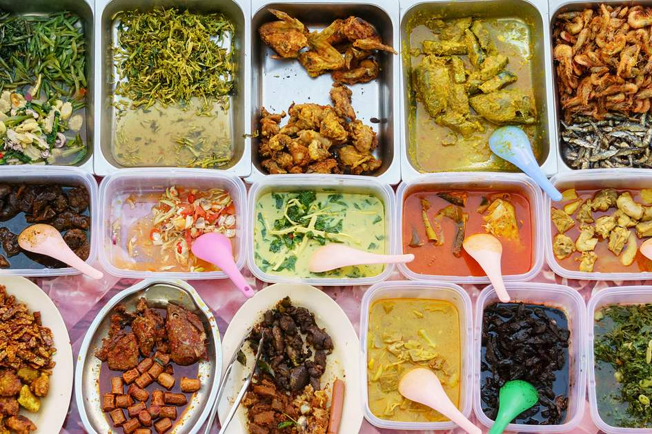 Hawker centres: a variety of delicious Malaysian home-cooked dishes sold at a street market stall in Kota Kinabalu, Sabah. Photo: Shutterstock