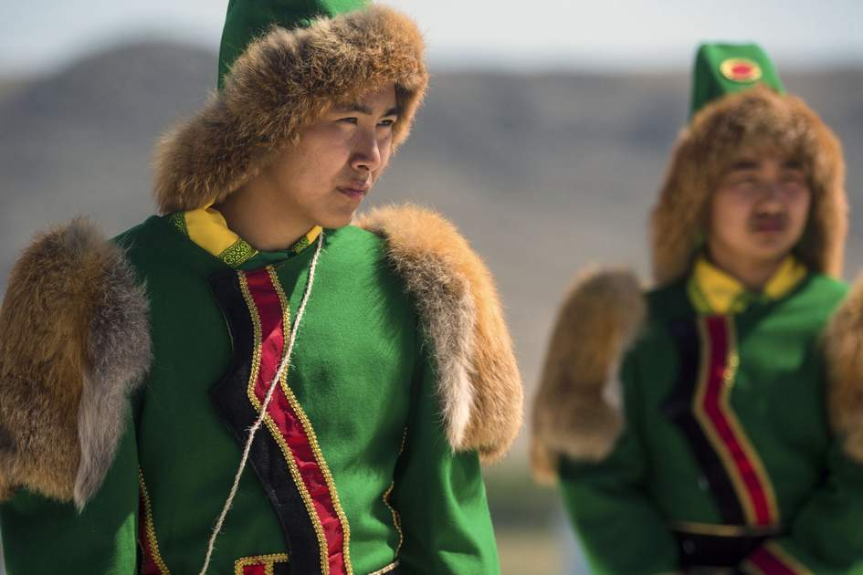Yakut men in traditional dress at the Erdyn Games in Siberia