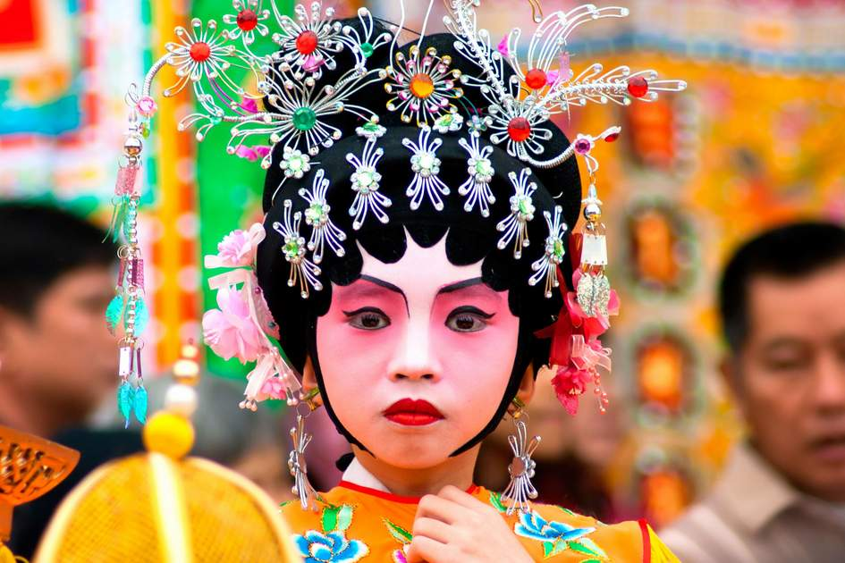 An unidentified child actor participates in a parade on Jan. 3, 2012. It is a non material cultural heritage, the traditional parade celebrating Chinese New Year, Guangzhou, China