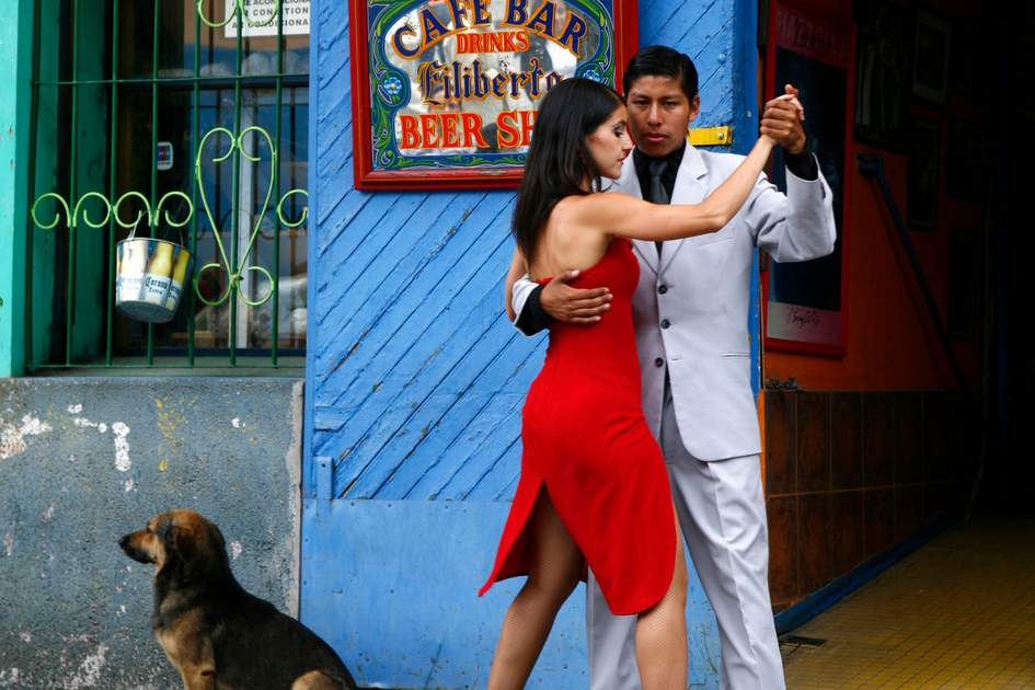 Couple dancing tango at La Boca district. Buenos Aires, Argentina