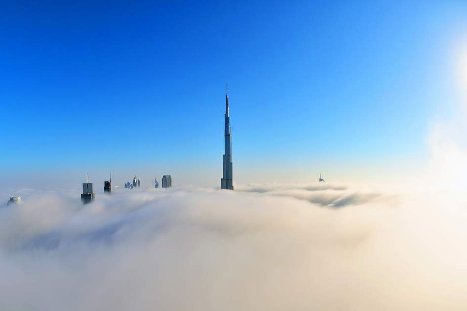 Dubai, Burj khalifa, the highest building in the world. Downtown is covered by early morning fog