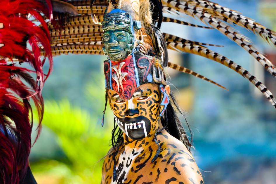 Mayan warrior in traditional dress, Tulum, Mexico
