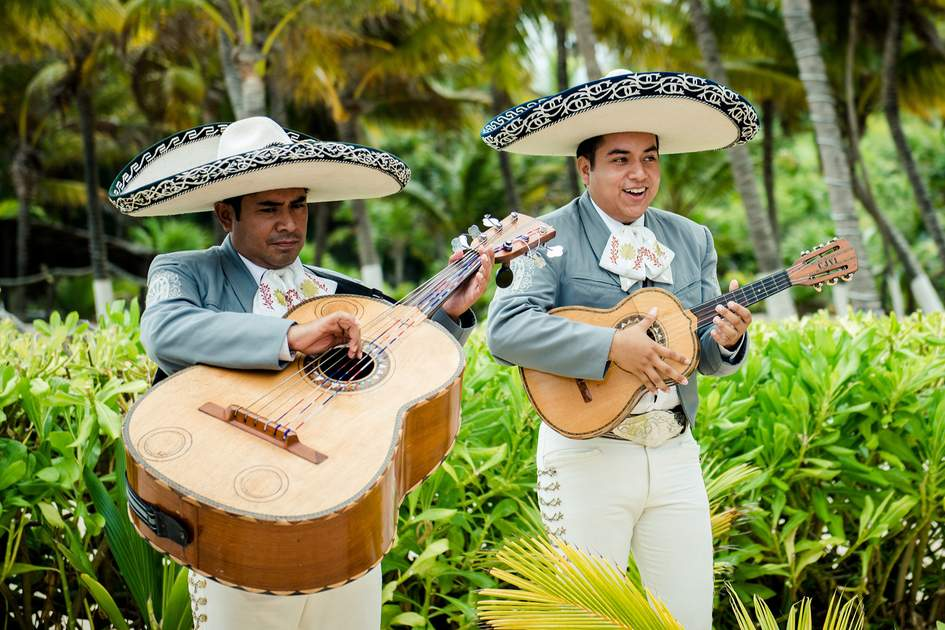 A Mariachi band plays Mexican music at a wedding in Cancun Mexico.