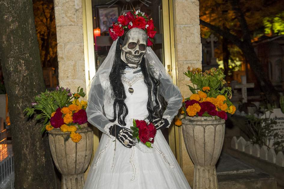 A person with a costume on a cemetery in the Day of the Dead in Oaxaca, Mexico