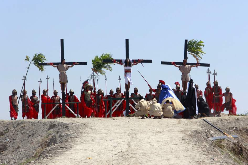 Penitents and actors in The Lenten Rites in Pampanga, Philippines.