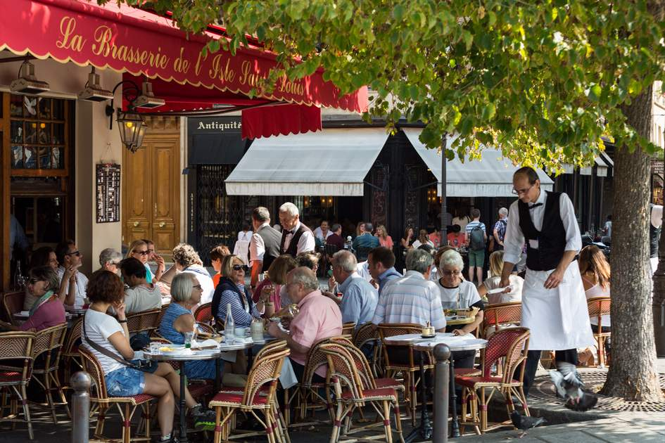 People visit typical Parisian cafe