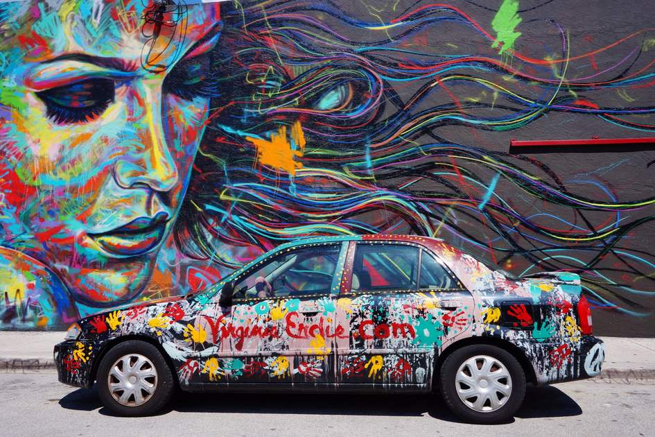 Graffitied car and wall, Miami.