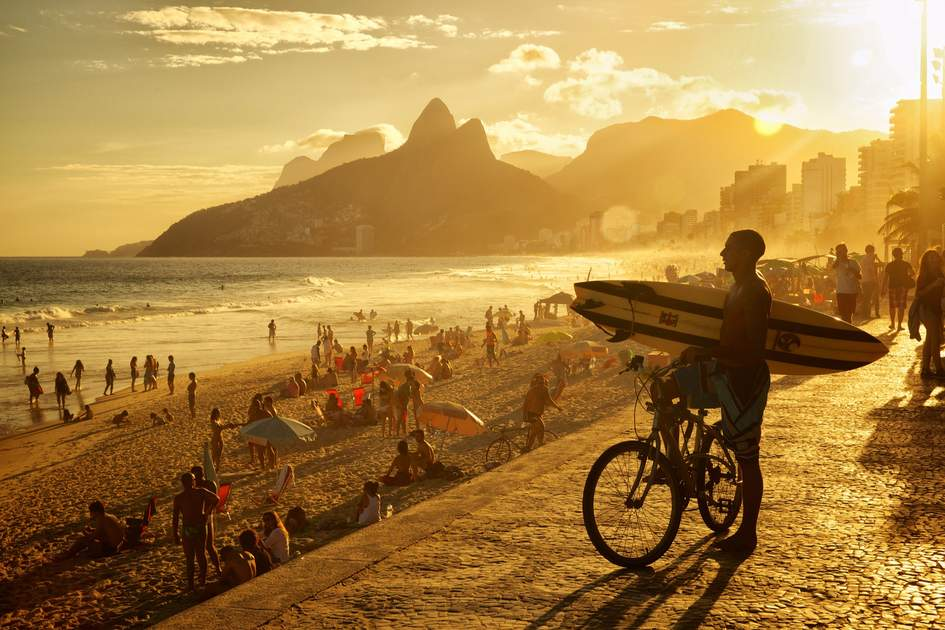 A surfer look towards the ocean at Praia de Ipanema. Photo: Shutterstock