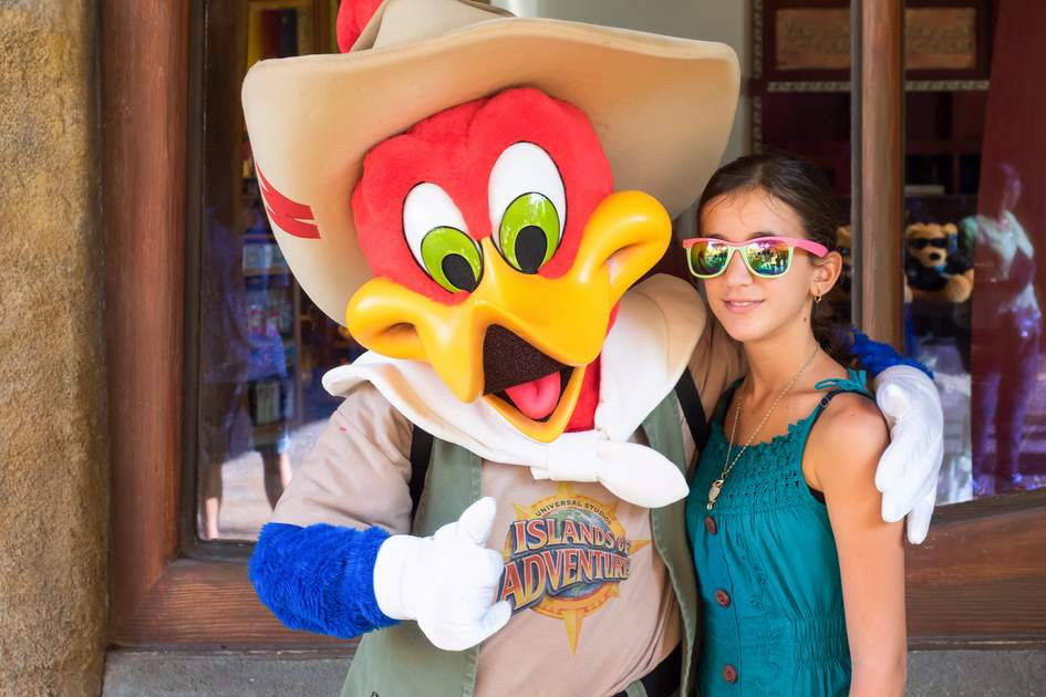 Girl posing with the Woody Woodpecker character at Universal Studios Islands of Adventure theme park