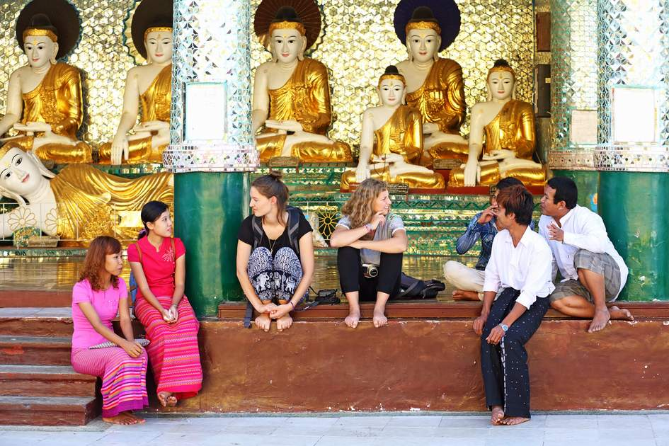 Unidentified talk to enjoy of burmese and foreign tourist at Shwedagon Pagoda in Yangon.