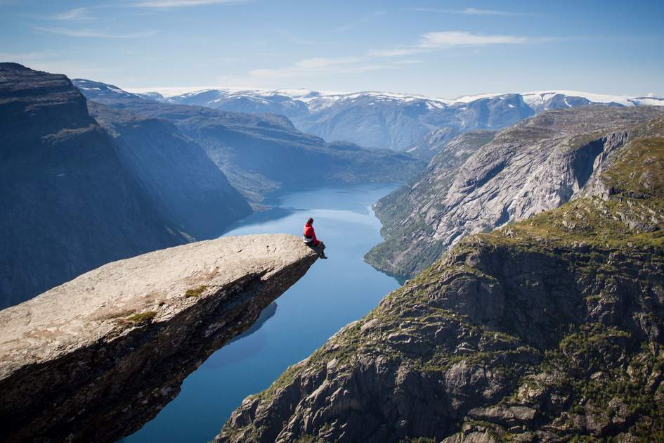Admiring the view from Trolltunga, Norway
