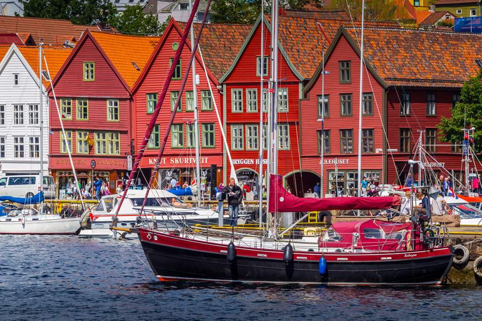 Famous Bryggen street with wooden colored houses in Bergen, Norway. Photo: Shutterstock
