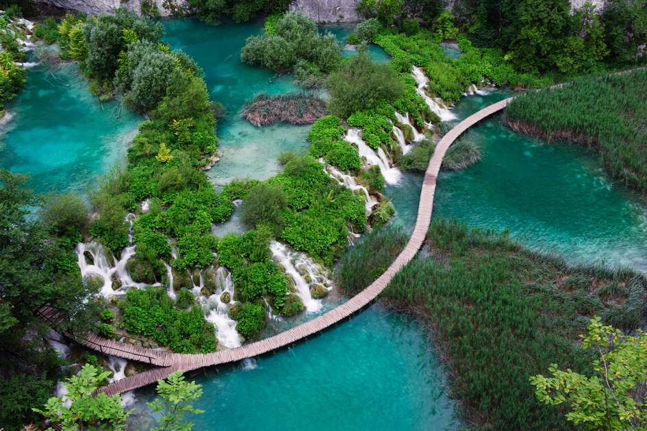 Waterfalls in Plitvice National Park, Croatia. One vivid turquoise lake flows into another.