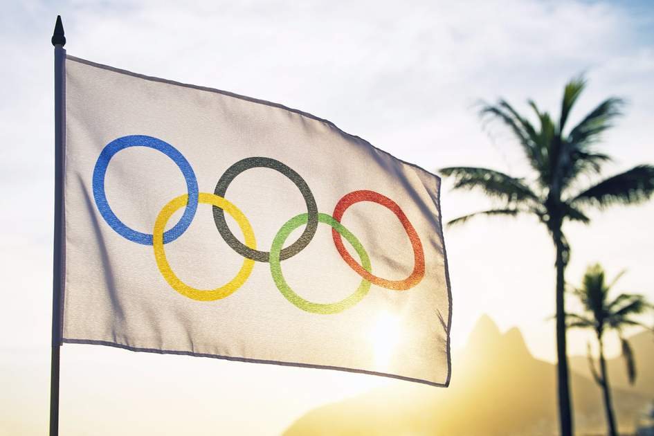 An Olympic flag at Ipanema Beach.