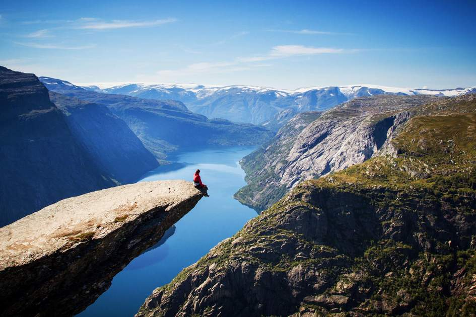Admiring the view from Trolltunga, Norway  (Photo: Alex Emanuel Koch/Shutterstock)