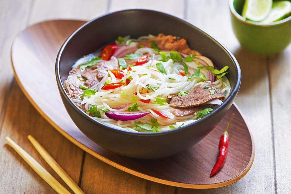 Pho bo, Vietnamese rice noodle soup with sliced beef. Photo: Shutterstock
