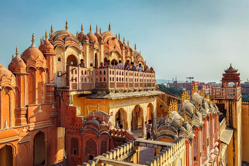 Tourist visiting Hawa Mahal palace (Palace of the Winds) famous Rajasthan tourism landmark. Photo: Shutterstock