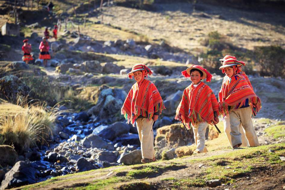 Unidentified people in traditional clothes in village Huilloc, Peru. Sacred Valley is most important regions of the Inca civilization.