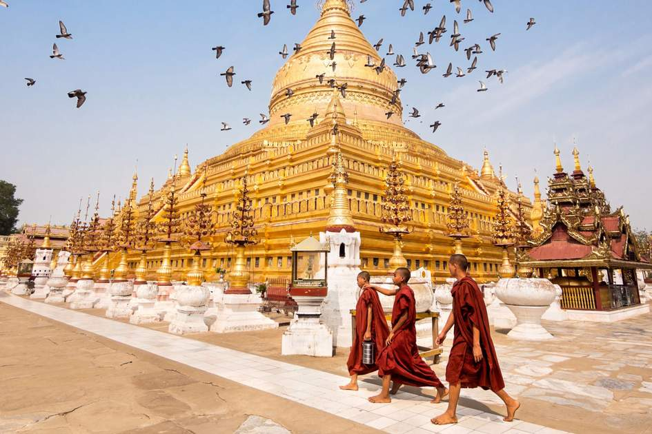 Novice Buddhist monks walking around the sacred Shwezigon Paya in Bagan, Myanmar. Photo: Shutterstock