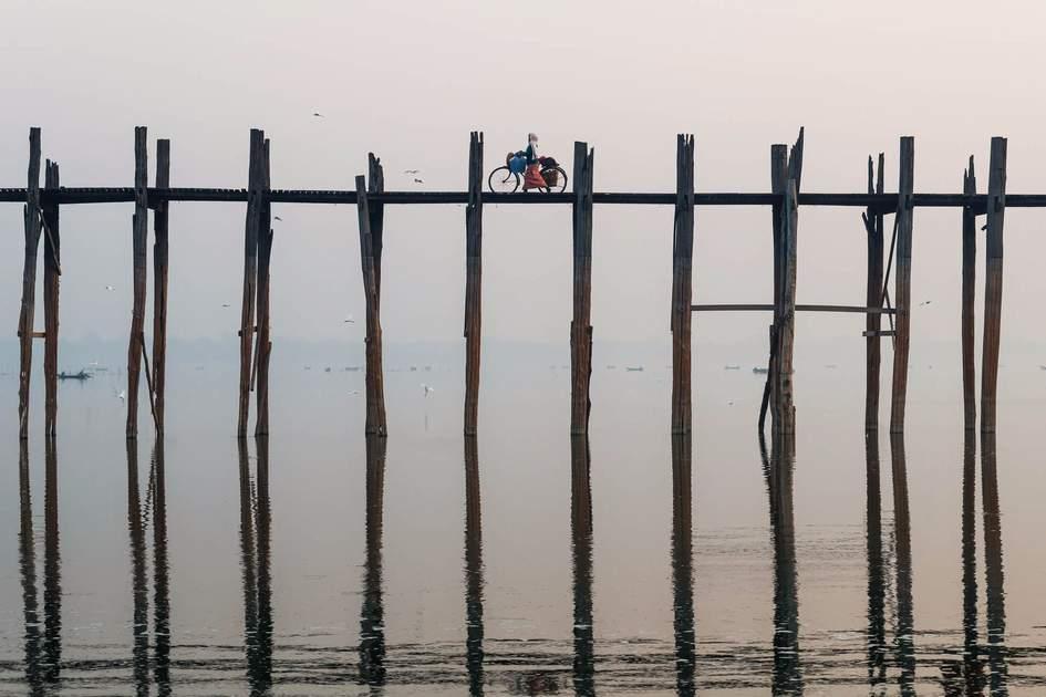 Crossing U Bein bridge, Myanmar
