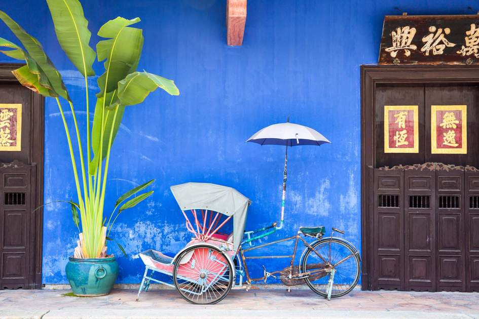 An old rickshaw tricycle near the Blue Mansion, Georgetown, Penang, Malaysia.