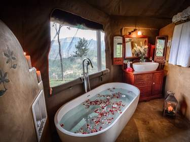 A luxurious bathroom at Madulkelle Tea & Eco Resort, one of Sri Lanka's best hotels for nature lovers