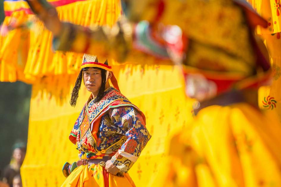 Costumed monk performs traditional dance at Wangdi Phodrang, Bhutan. Photo: Shutterstock