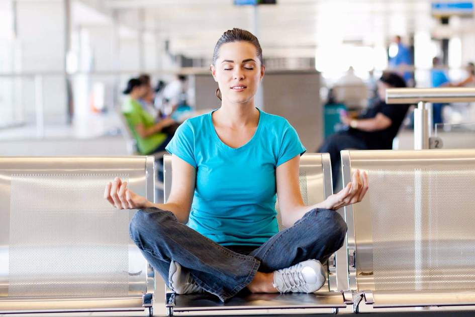 Yoga meditation at airport. Photo: Shutterstock