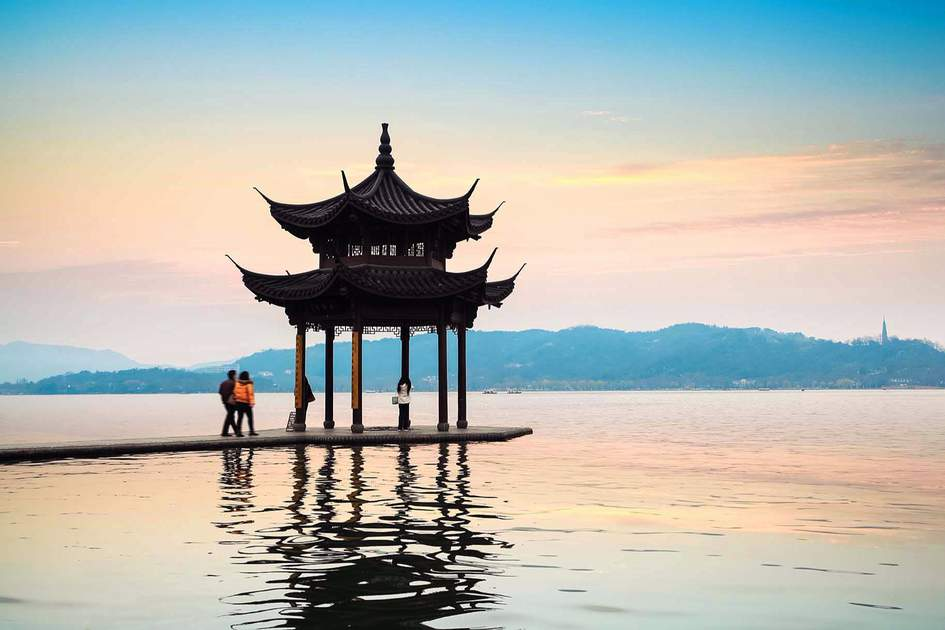 Sunset at serene West Lake in Hangzhou, Zhejiang, China – one of the world's most relaxing destinations. Photo: Shutterstock