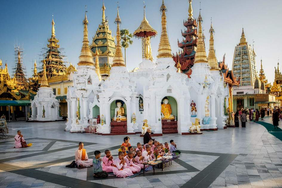monks posing in Swedagon Pagoda on March 29, 2015 in Yangoon
