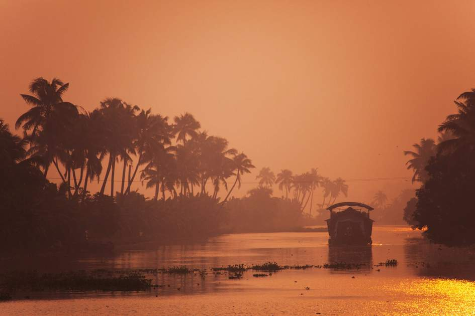 Tourist houseboat at sunset, Kerala