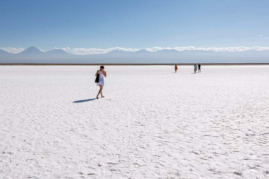 Tourists on the salt flats in the Atacama Desert