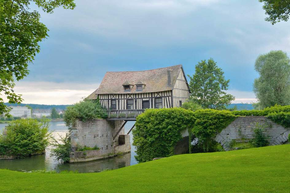 An old mill house on the Seine River in Vernon, Normandy