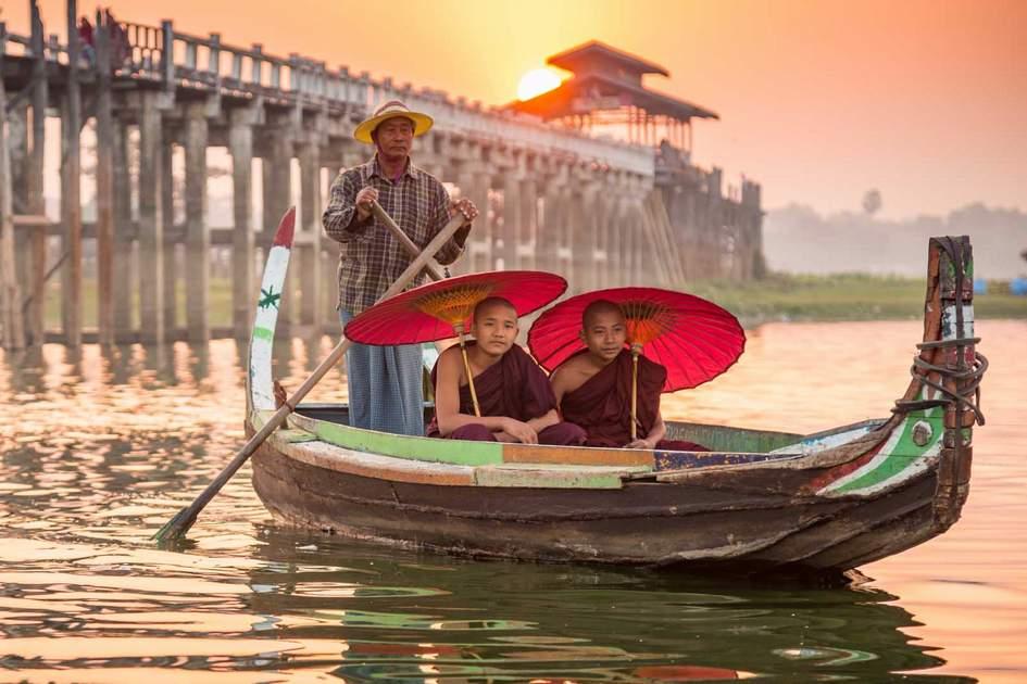 February sunset at U Bein bridge across the Taungthaman Lake, Mandalay, Myanmar. Photo: Shutterstock