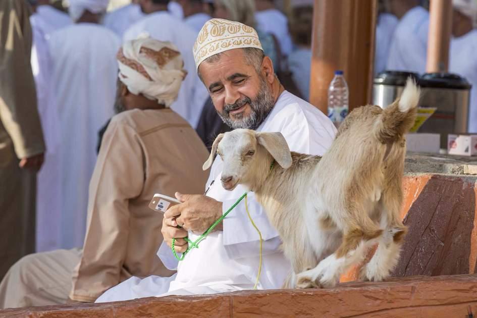 Omani man with his goat in Nizwa market