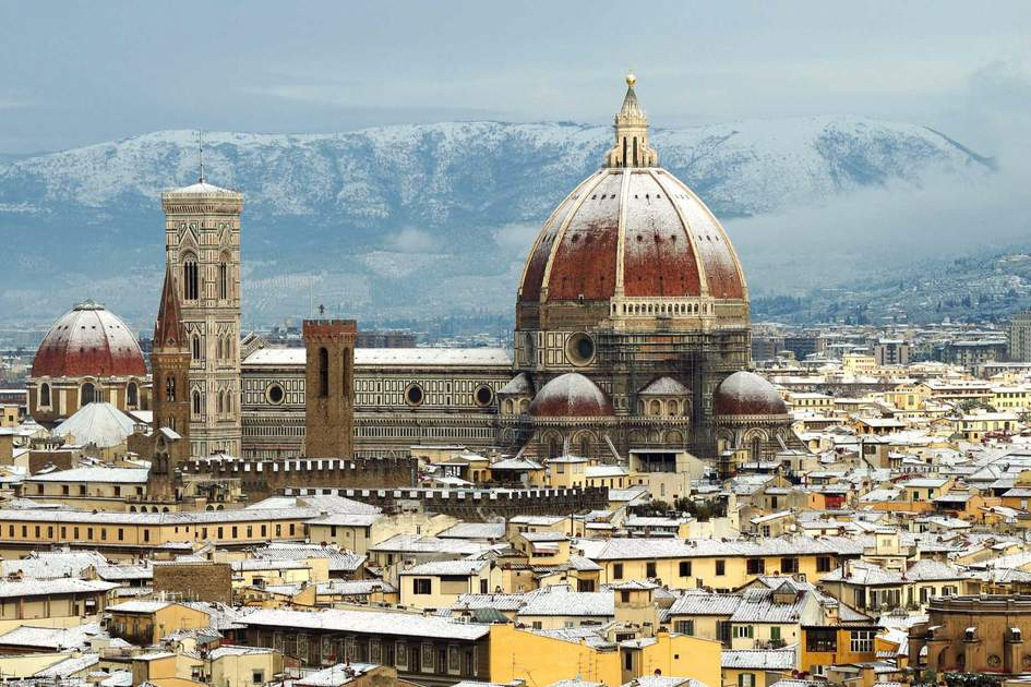 cathedral Santa Maria del Fiore (Duomo) and giottos bell tower (campanile), in winter with snow Florence