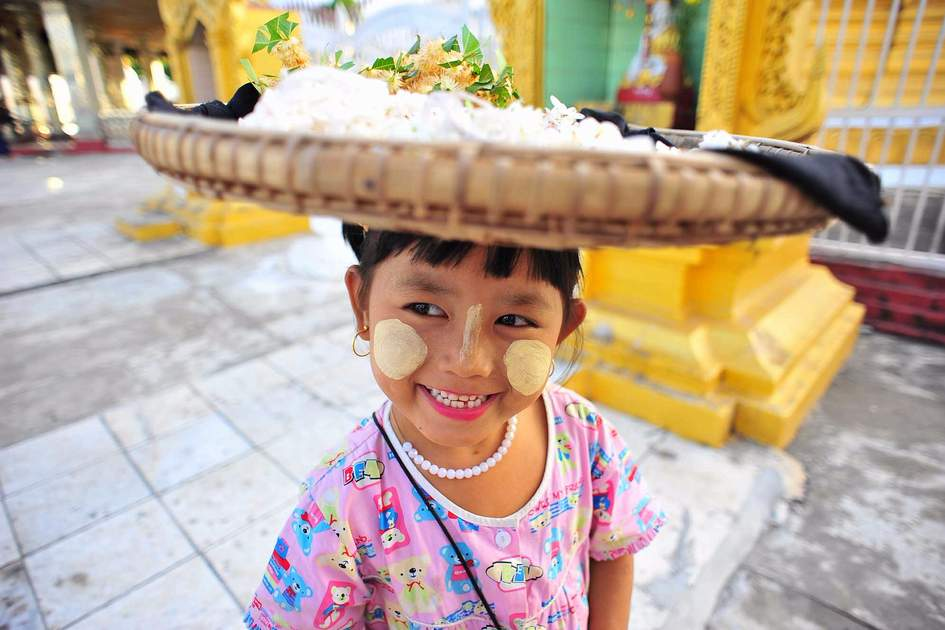 Selling flowers at Mandalay Temple, Myanmar