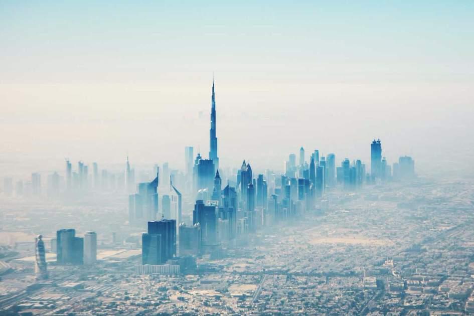 Dubai city in sunrise aerial view. Photo: Shutterstock