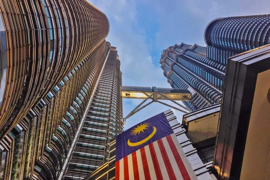 Petronas Towers. Petronas Towers with Malaysia national flag, Kuala Lumpur.