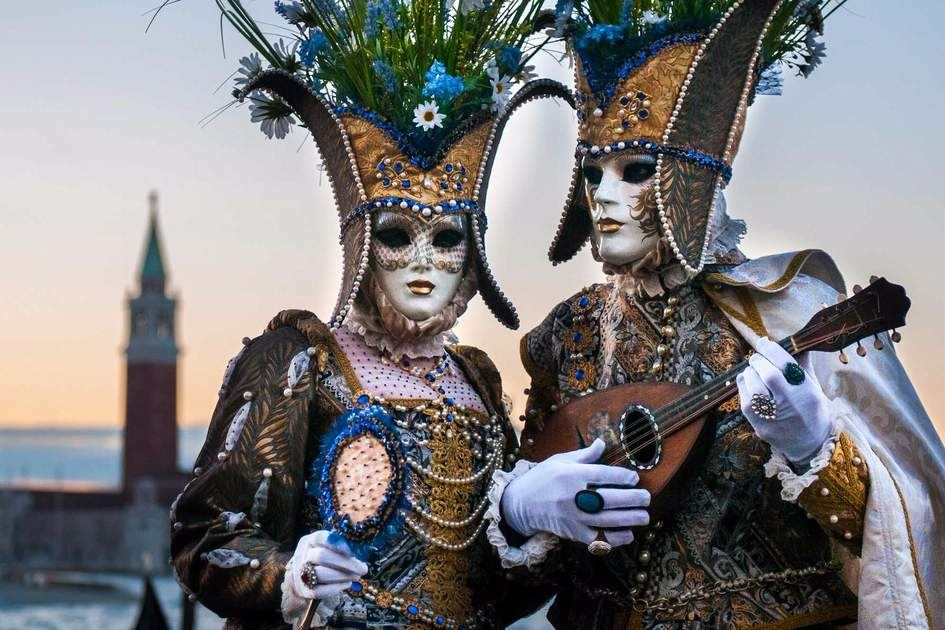 A couple of masks at St. Mark square during the carnival of Venice. Photo: Shutterstock