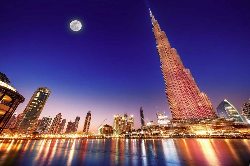 Burj Khalifa and fountain - world's tallest tower at 828m at night with moon light. Photo: Shutterstock