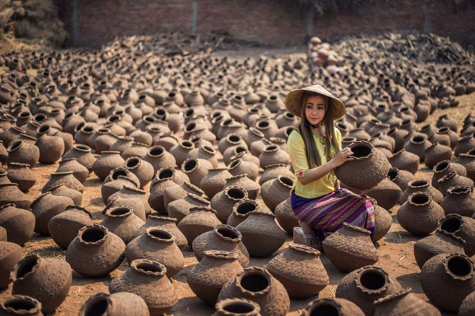 Worker Women, Happy asian traditional harvest at Mandalay Myanmar, carrying pots in Myanmar traditional costume
